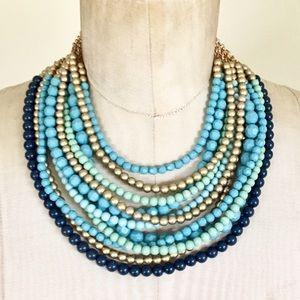 Blue bib necklace statement